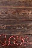 Amour de Word écrit avec le fil de laine Images stock