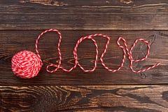 Amour de Word écrit avec le fil de laine Image stock