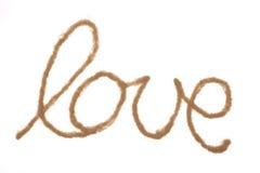 Amour de Word écrit avec le sable Photos libres de droits
