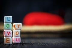 Amour de Word écrit dans les blocs en céramique Photo libre de droits