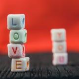 Amour de Word écrit dans les blocs en céramique Image libre de droits