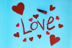 Amour de Word écrit par le rouge à lèvres Photo stock