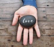 Amour de Word écrit sur la pierre Image stock