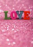 Amour de Word avec le fond éclatant Photographie stock libre de droits