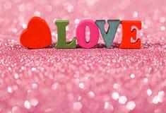 Amour de Word avec le fond éclatant Photos stock