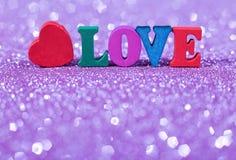 Amour de Word avec le fond éclatant Images libres de droits