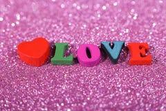 Amour de Word avec le fond éclatant Image stock