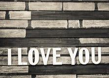 Amour de Word avec le vieux fond en bois Photo stock