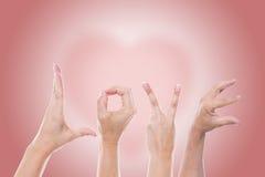 Amour de Word devant un coeur Images libres de droits