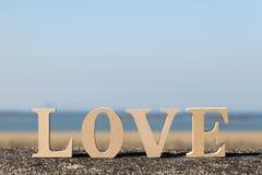 Amour de Word fait avec le bloc en bois Images libres de droits