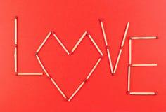 Amour de Word fait d'allumettes Images stock