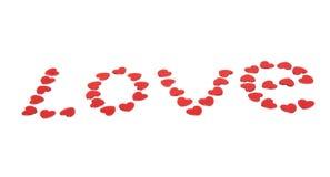 Amour de Word rassemblé de petits coeurs rouges Photo libre de droits