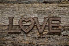Amour de Word sur le bois rustique Photos stock