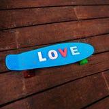 Amour de Word sur le panneau bleu de penny Photo libre de droits