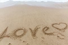 Amour de Word sur le sable Photographie stock
