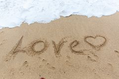 Amour de Word sur le sable Photo libre de droits