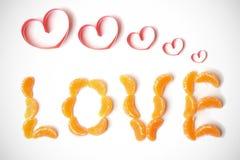 Amour des segments de mandarine Photographie stock libre de droits
