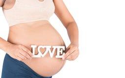 Amour des textes de prise de femme enceinte Photographie stock libre de droits