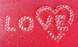 Amour des textes disposé des cristaux Images libres de droits