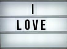 Amour du caisson lumineux i Photographie stock libre de droits