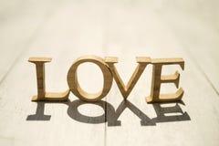 Amour en bois avec la lumière de matin Photos libres de droits