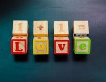 amour en bois de mot Photographie stock