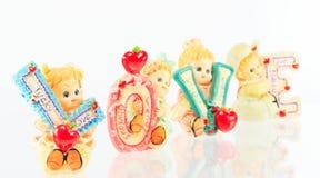 Amour en céramique de poupée   Photographie stock