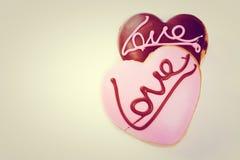 Amour en forme de coeur d'écriture de dessert Image libre de droits