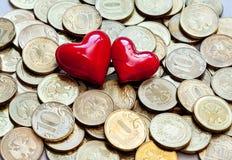 Amour et argent de pièces de monnaie Image libre de droits