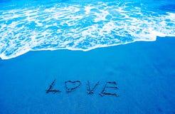 Amour et plage Photographie stock libre de droits