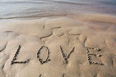 Amour et plage Photo stock