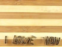 Amour et planche à découper de pain Photographie stock libre de droits