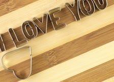 Amour et planche à découper de pain Image stock
