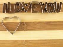 Amour et planche à découper de pain Photo stock