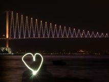Amour et pont de Bosphorus Images stock