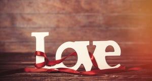 Amour et rayures de Word sur une table Images libres de droits