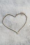 Amour et sable Photographie stock