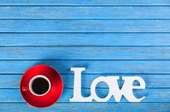 Amour et tasse de Word Photo stock
