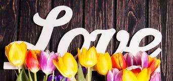 Amour et tulipe d'inscription Photographie stock