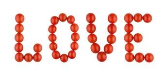 AMOUR fait à partir des tomates rouges sur le fond blanc, d'isolement Images libres de droits