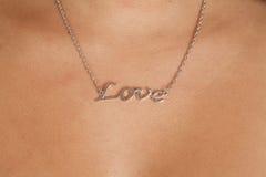 Amour indiquant le collier Photos stock