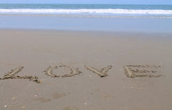 Amour, inscription sur le sable, Photo stock