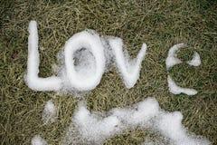 Amour. Message fait en neige. Images libres de droits