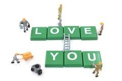 Amour miniature de mot de renforcement d'équipe de travailleur vous Images stock