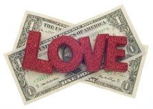 Amour ou argent Photographie stock