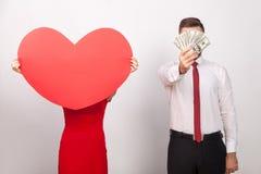 Amour ou argent ? Ce qui est meilleur, votre choix Image stock