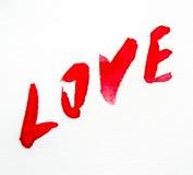 Amour rouge de mot peint par aquarelle Photos stock