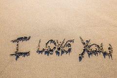 Amour sculpté dans le sable Photographie stock libre de droits