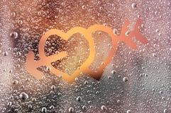 Amour sur Frosty Window Photographie stock libre de droits