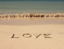 Amour sur la plage Photos libres de droits